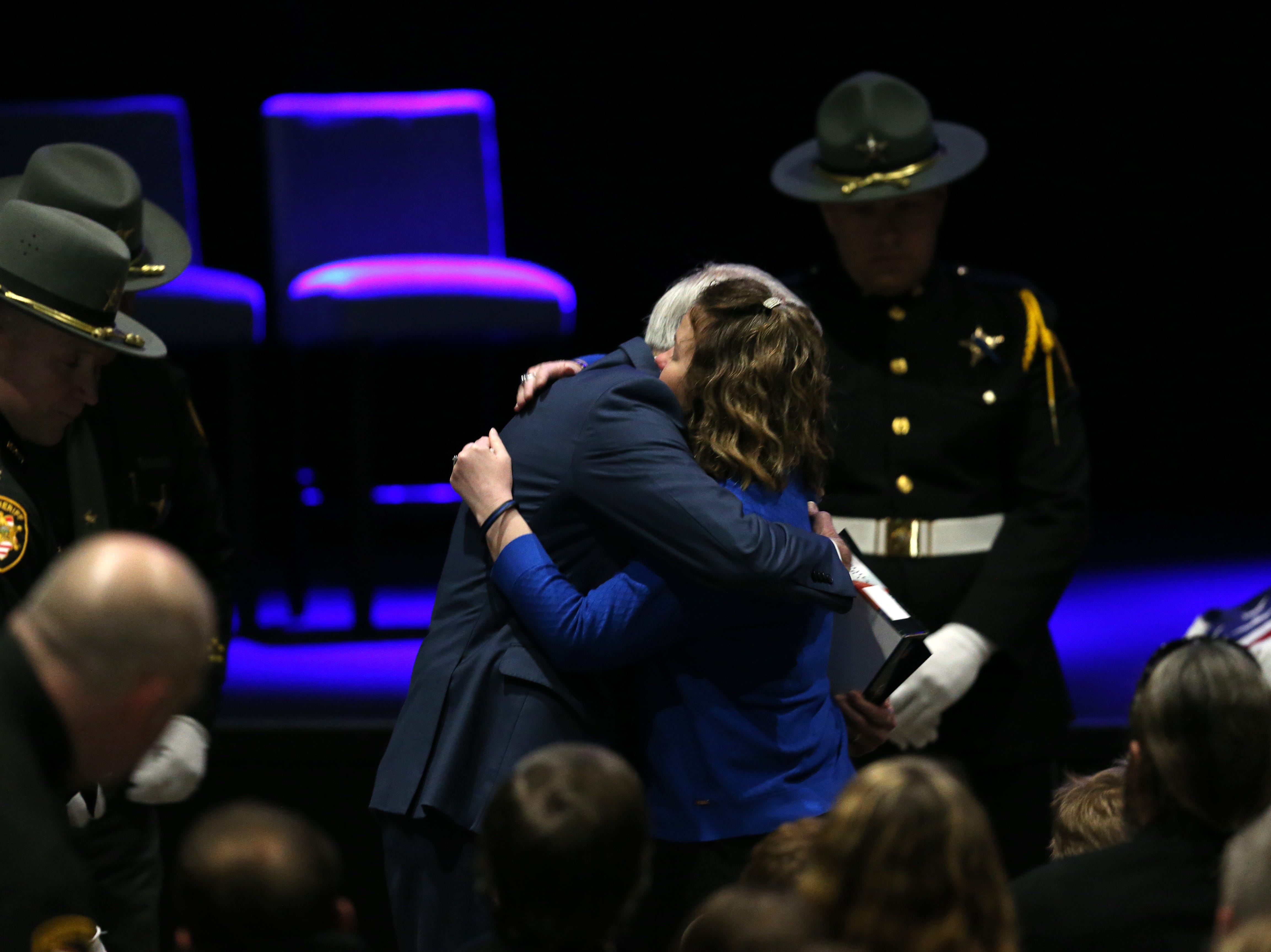 U.S. Sen. Rob Portman embraces Jamie Brewer, widow of fallen Clermont County Sheriff's Detective William Lee Brewer Jr. during funeral services, Friday, Feb. 8, 2019, at Mount Carmel Christian Church in Union Township, Ohio. Brewer, a 20-year veteran of the Clermont County SheriffÕs Office, died in the line of duty. He was shot Feb. 2 during a standoff. Brewer, 42, of Pierce Township, is survived by his wife, Jamie, and a 5-year-old son, Braxton. (Kareem Elgazzar/The Cincinnati Enquirer)