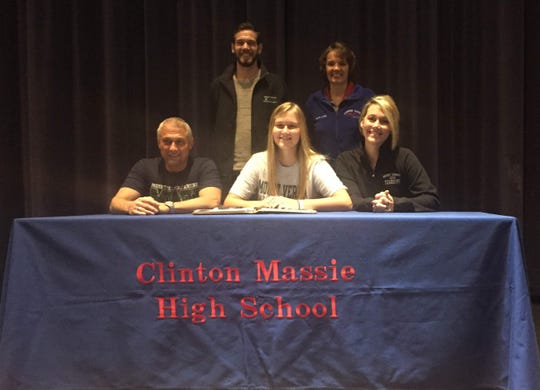 Clinton-Massie senior Hailey Clayborn, front center, signs her letter of intent to play tennis for Mount Vernon Nazarene University. With her are her parents Gregg, front left, and Pam, front right, MVNU Coach Daniel Doan, back left, and CM coach Lynn Deatherage, back right.