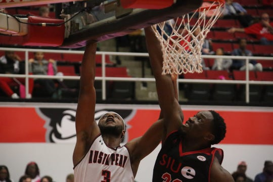 Austin Peay's Chris Porter-Bunton (3) goes up for a shot under the basket against an SIU Edwardsville player during their OVC game Thursday at the Dunn Center.