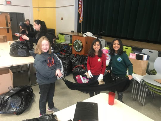 Emily O'Neill of Garwood, Ariana Noor and Duaa Noor of Colonia help sort items during the MLK Jr. Day of Service at Wardlaw+Hartridge.