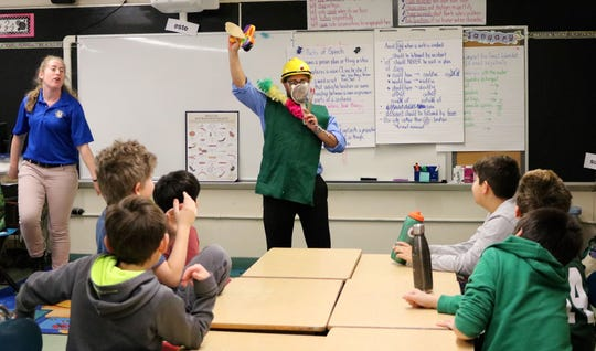 """Tamaques 5th grade teacher Victor Alfonso dresses as a macroinvertebrate during a visit from NJDEP """"watershed ambassadors.""""  Different types of these small organisms tolerate different stream conditions and can help to indicate clean or polluted water."""