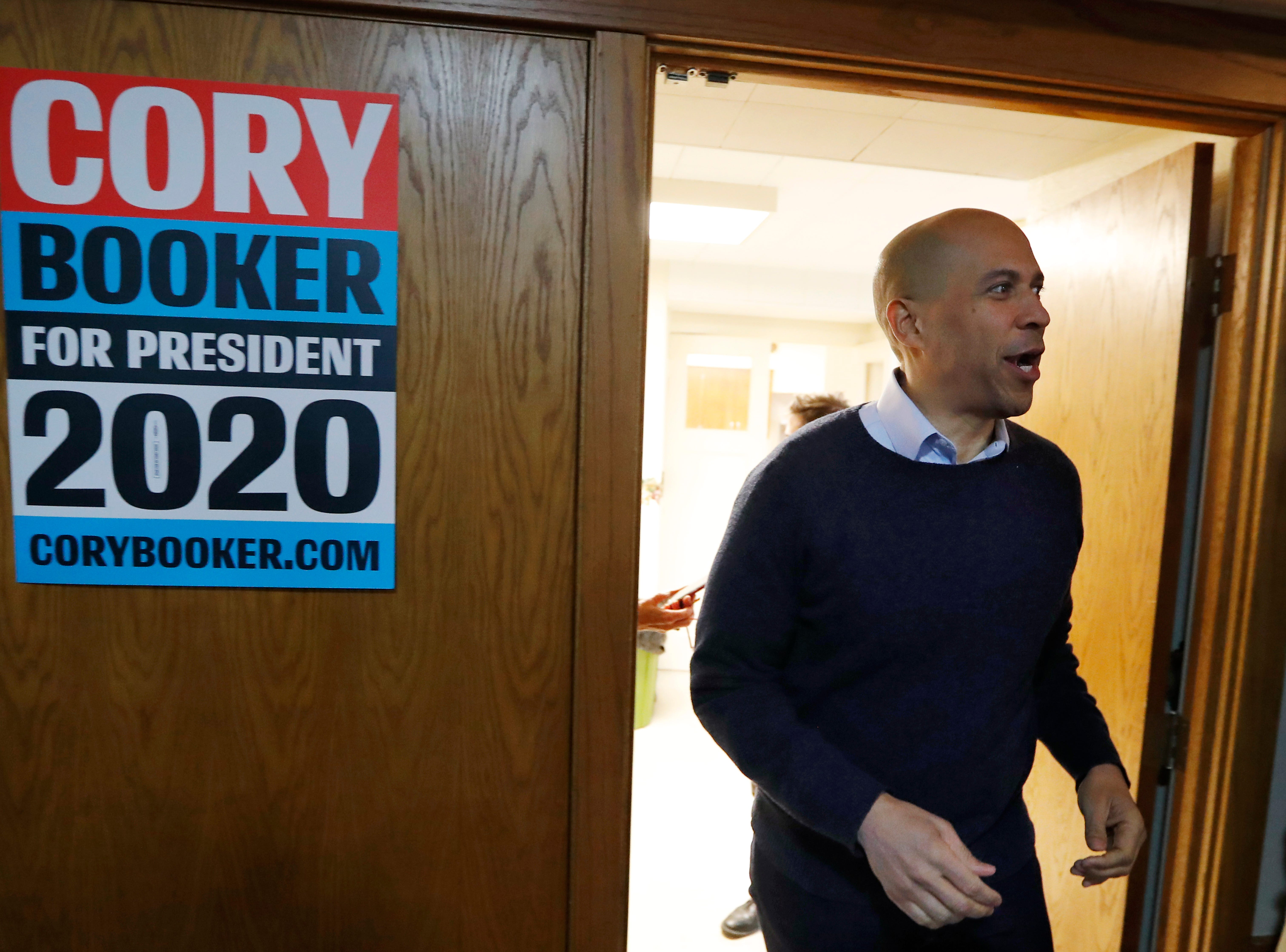 U.S. Sen. Cory Booker, D-N.J., arrives at a meet and greet with local residents at the First Congregational United Church of Christ, Friday, Feb. 8, 2019, in Mason City, Iowa. (AP Photo/Charlie Neibergall)