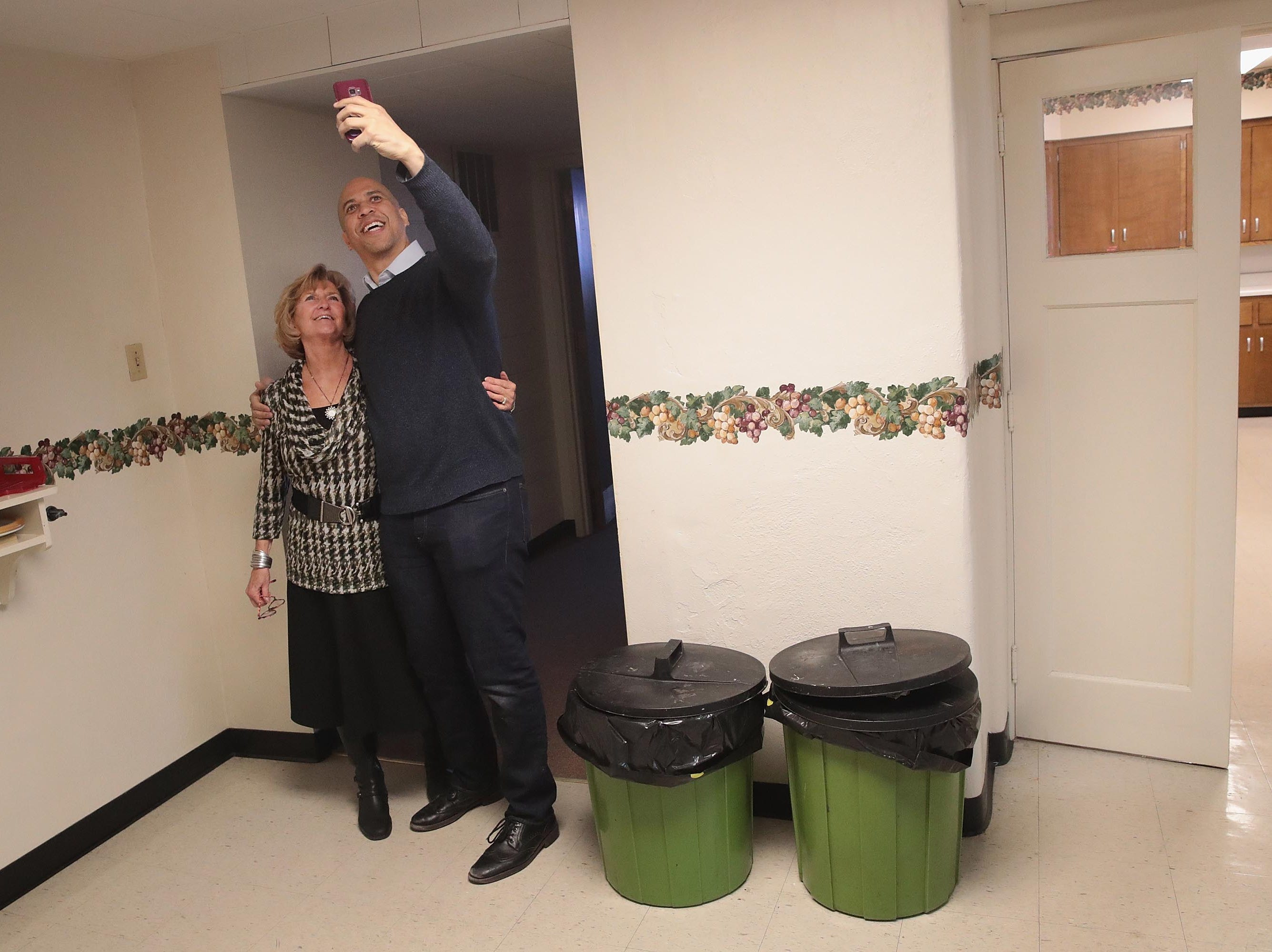 MASON CITY, IOWA - FEBRUARY 08: U.S. Senator Cory Booker (D-NJ) takes a selfie with Iowa State Representative Sharon Steckman during a campaign event in the basement at the First Congressional United Church of Christ on February 08, 2019 in Mason City, Iowa.  Booker, whose has family from Iowa, is in the state campaigning for the 2020 Democratic nomination for president. (Photo by Scott Olson/Getty Images)