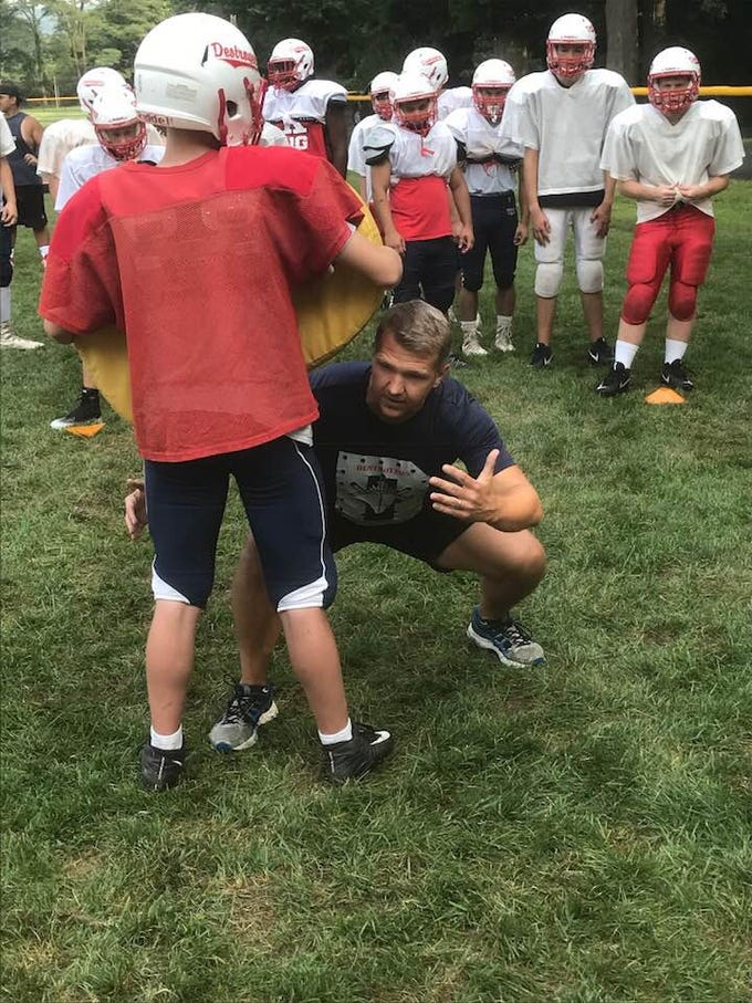 This summer, Chris Washburn taught the Dunellen High School football team how to tackle rugby style.