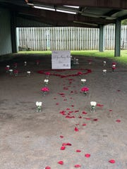 Rose petals line the Stable pavilion for a special marriage proposal at Lord Stirling Stable.