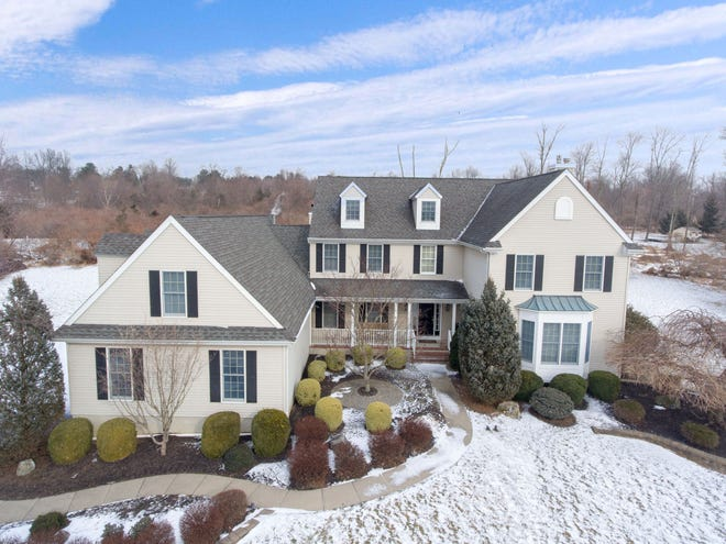 A custom Colonial sited on 2.13 open, level and landscaped acres bordering permanently preserved open space woodlands is newly available in Raritan Township.