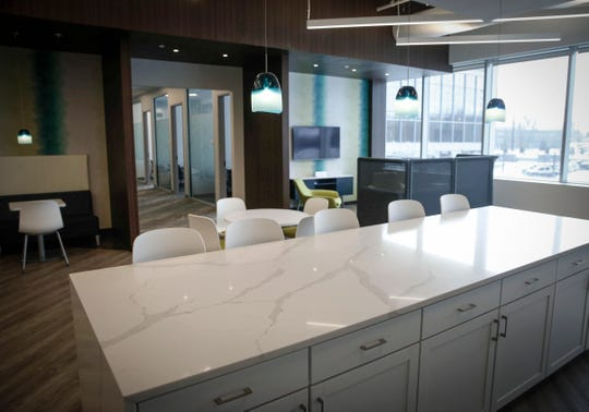 A spacious kitchen and dining area is featured at the new Westfield office building in West Des Moines.