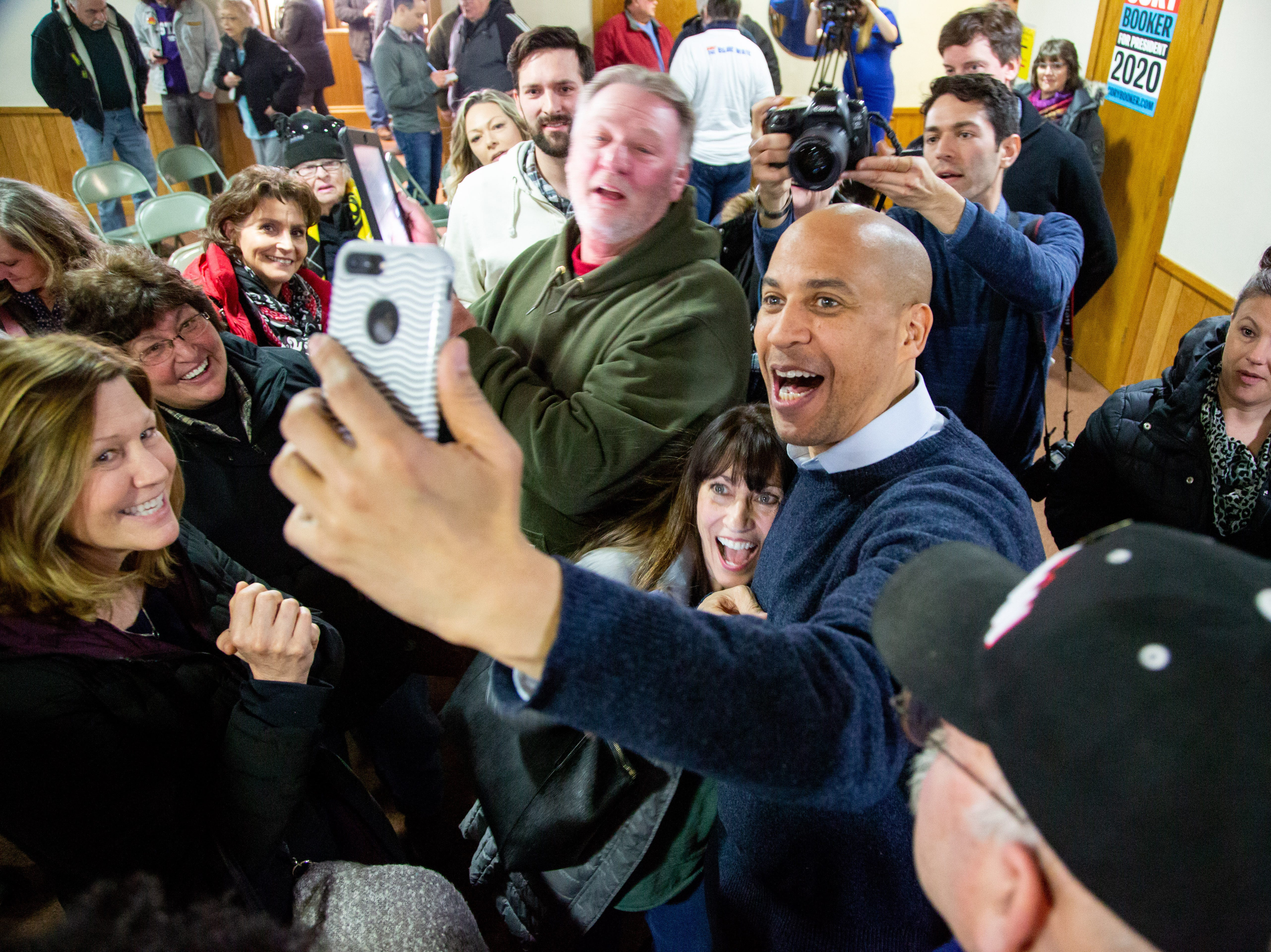 Sen. Cory Booker, D-N.J., takes selfies with the audience after a meet and greet at the First Congregational United Church of Christ, Friday, Feb. 8, 2019, in Mason City, Iowa. Friday, Feb. 8, 2019.