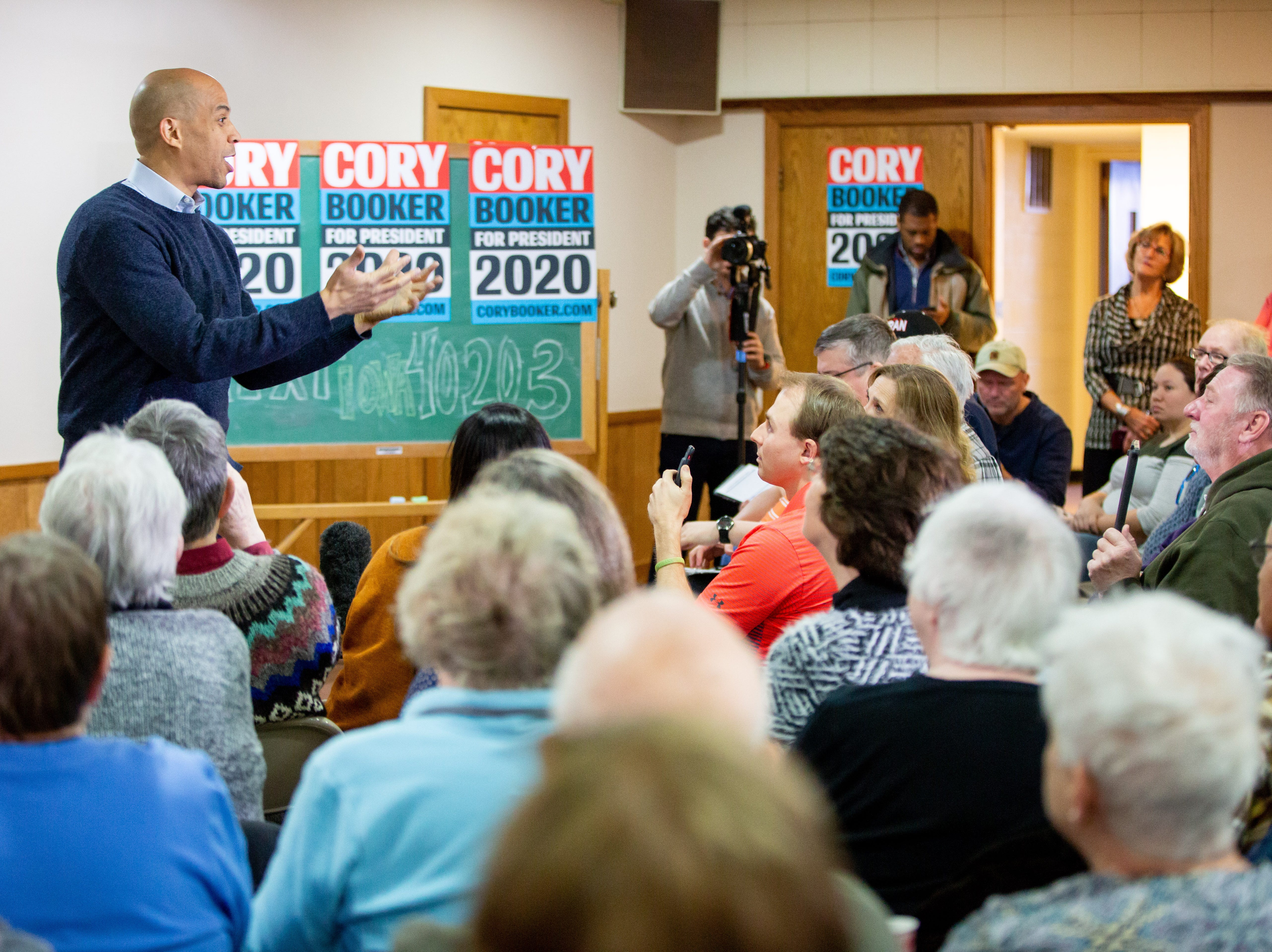 Sen. Cory Booker, D-N.J., speaks during a meet and greet at the First Congregational United Church of Christ in Mason City Friday, Feb. 8, 2019.
