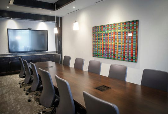 A large office room flooding with local art hanging on the wall at the new Westfield office building in West Des Moines on Thursday, Feb. 7, 2019.