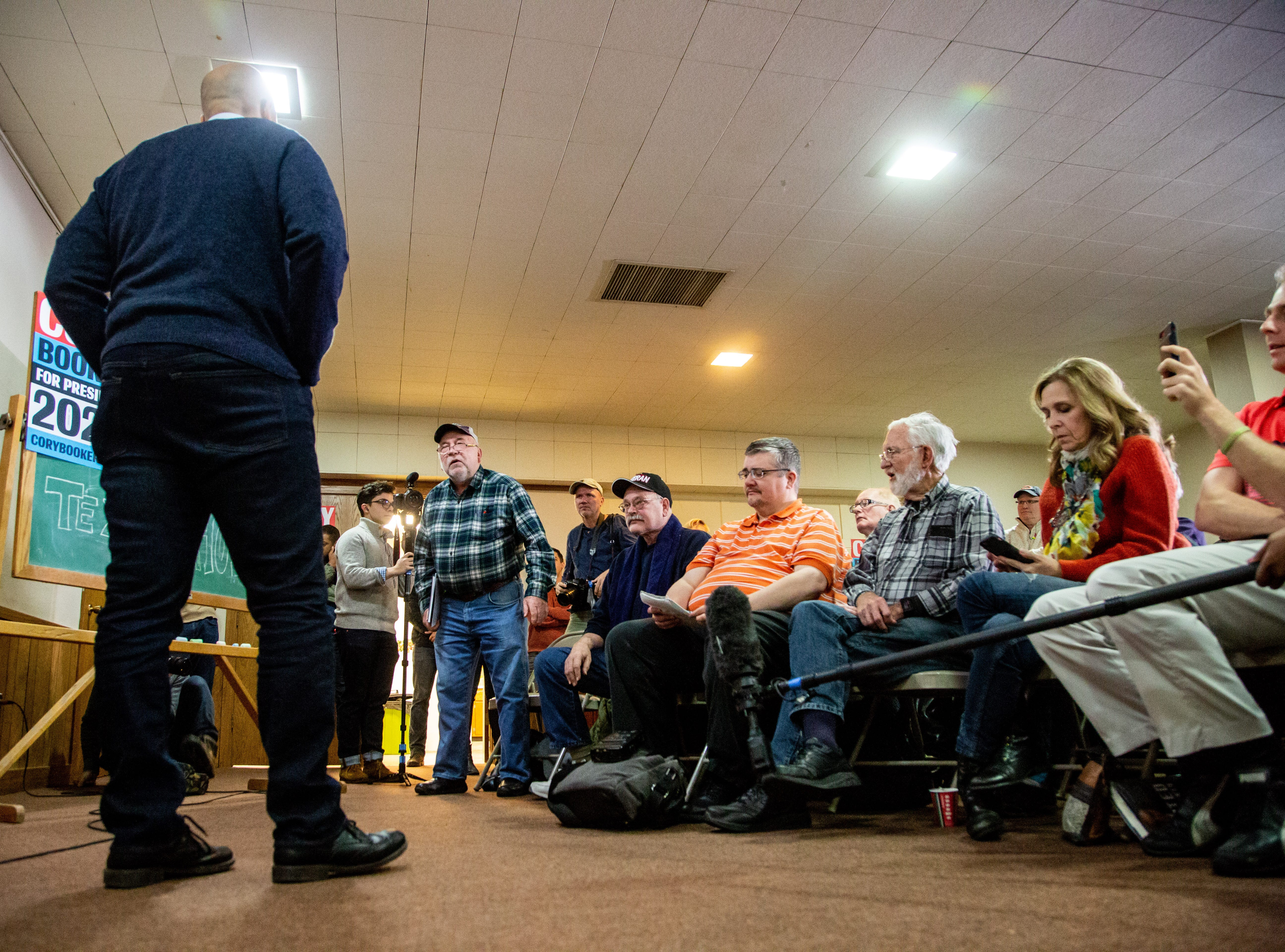 Sen. Cory Booker, D-N.J., takes a question from Chris Petersen of Clear Lake during a meet and greet at the First Congregational United Church of Christ in Mason City Friday, Feb. 8, 2019.