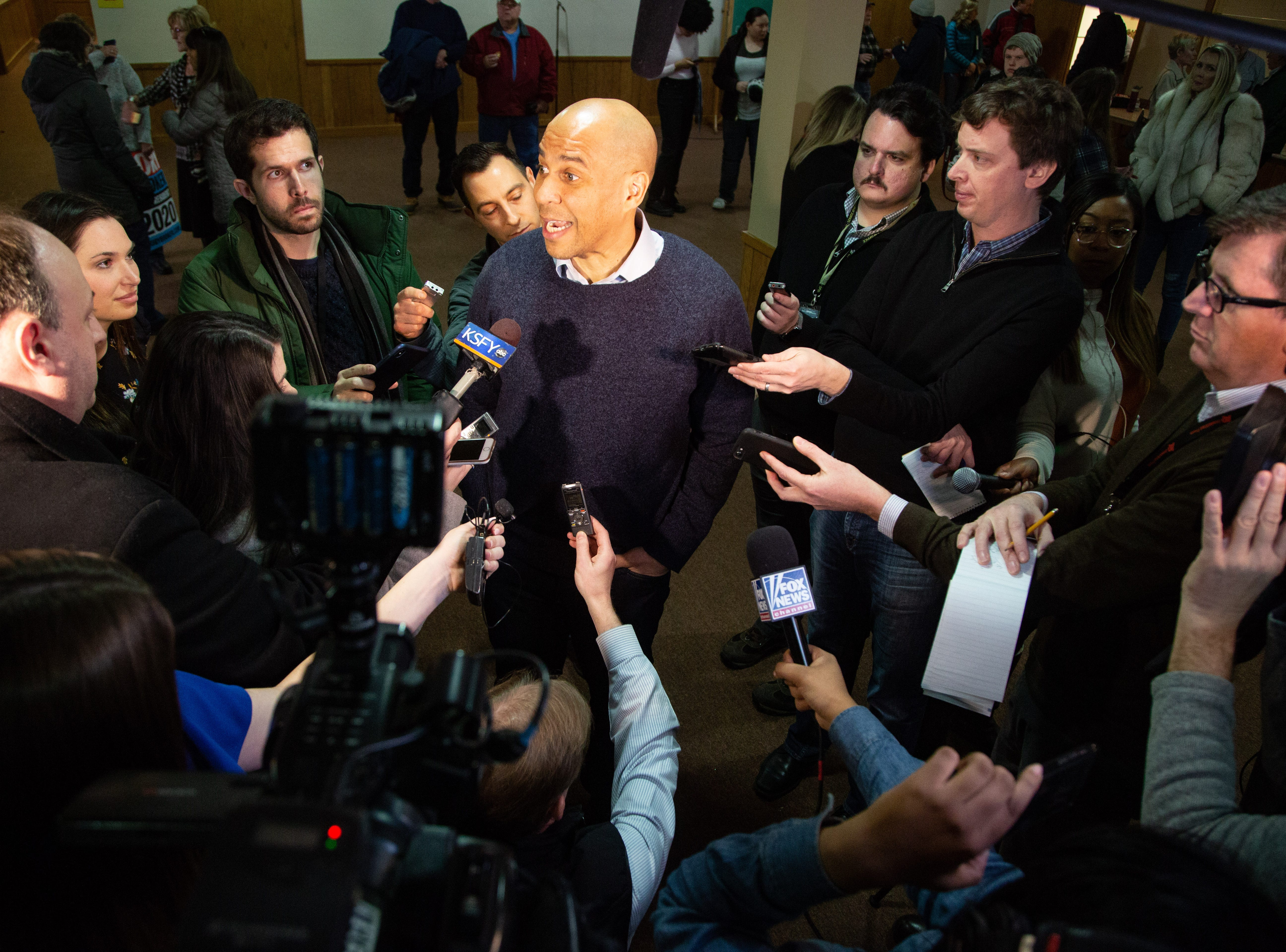 Sen. Cory Booker, D-N.J., speaks with reporters after a meet and greet at the First Congregational United Church of Christ in Mason City Friday, Feb. 8, 2019.