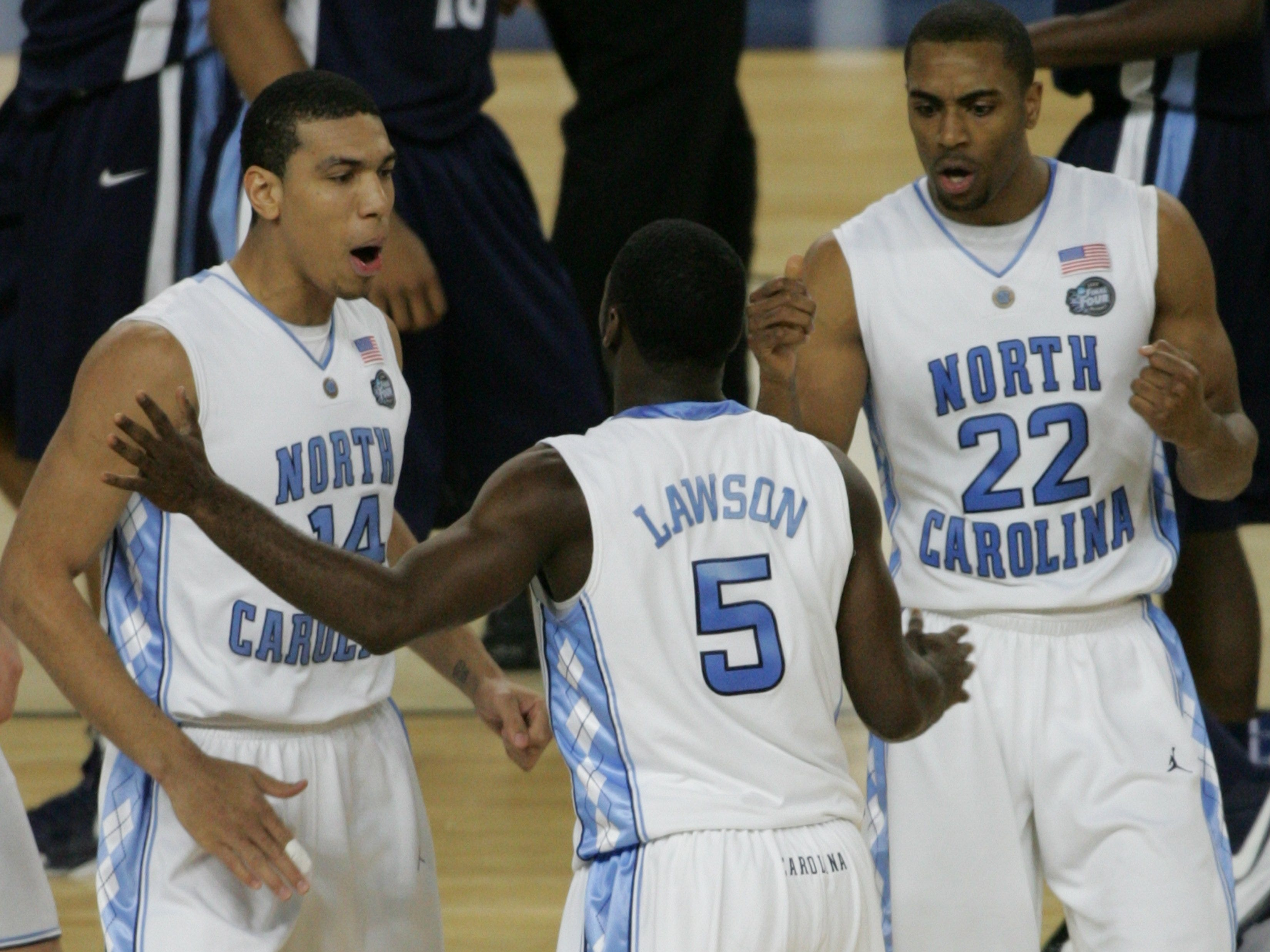 North Carolina's Danny Green, left, Ty Lawson, center, and Wayne Ellington celebrate a play during the NCAA Final Four semifinal against Villanova at Ford Field in Detroit, April 4, 2009.