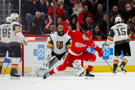 Detroit Red Wings center Michael Rasmussen (27) celebrates his goal against Vegas Golden Knights goaltender Marc-Andre Fleury (29) on Thursday in Detroit.