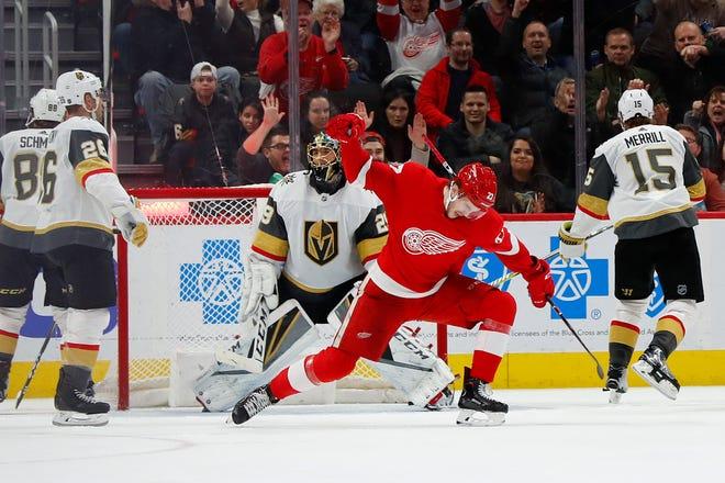 Detroit Red Wings center Michael Rasmussen (27) celebrates his goal against Vegas Golden Knights goaltender Marc-Andre Fleury (29) on Thursday in Detroit.