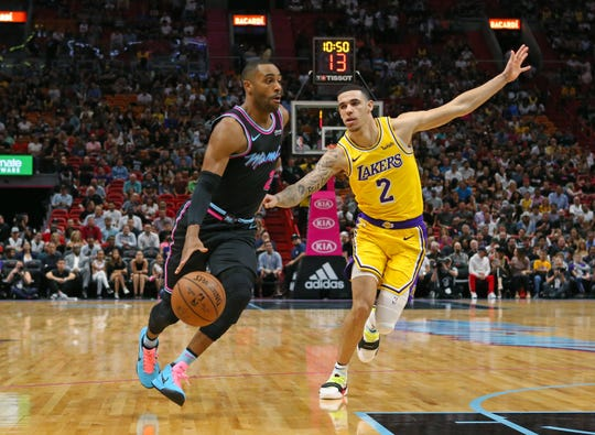 Wayne Ellington drives against Lakers guard Lonzo Ball on Nov. 18, 2018 in Miami.
