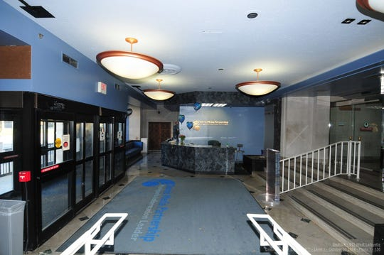 "Here's a ""before"" shot of the old Detroit News building lobby at 615 W. Lafayette before Bedrock restored it to its original look. Note the drop ceiling and other modernizing touches."