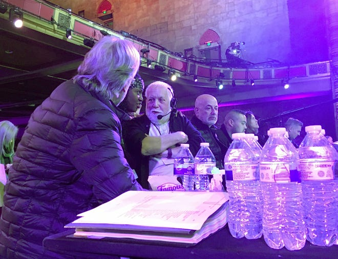 "Grammy Awards executive producer Ken Ehrlich (center with headset) speaks with Recording Academy president Neil Portnow on Jan. 13, 2019, at the Shrine Auditorium in Los Angeles. Ehrlich was leading rehearsals for ""Aretha! A Grammy Celebration for the Queen of Soul."""