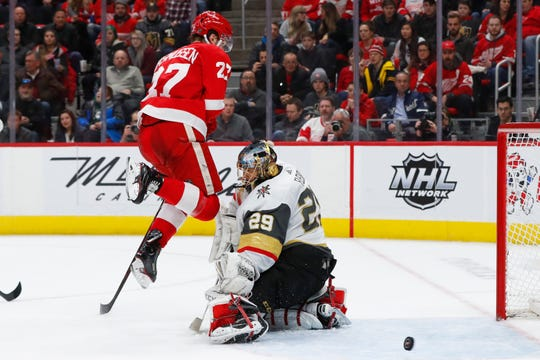 Vegas Golden Knights goaltender Marc-Andre Fleury (29) blocks a shot as Detroit Red Wings center Michael Rasmussen (27) jumps out of the way on Feb. 7, 2019, in Detroit.