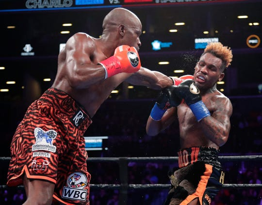Tony Harrison punches Jermell Charlo during the seventh round of the WBC super welterweight championship boxing match Saturday, Dec. 22, 2018, in New York. Harrison won the fight. (AP Photo/Frank Franklin II)