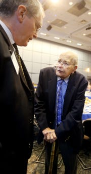 Congressman John D. Dingell speaks his son Christopher Dingell during the Shining Light Regional Cooperation Awards on Thursday, Oct. 9, 2014.