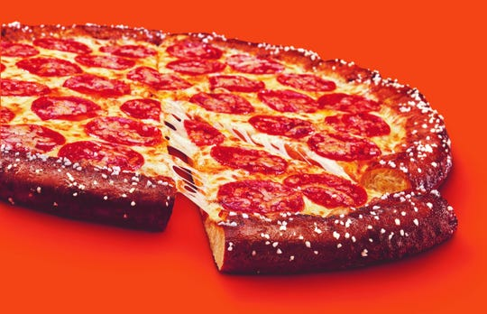 Little Caesars Pretzel crust pizza is back is $6 for National Pizza Day.