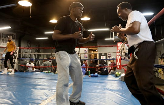 (L to R) WBC Super Welterweight champion Tony Harrison and Detroit boxing legend Thomas Hearns work out in the ring of Harrison's SuperBad Fitness on Puritan Avenue in Detroit on Friday, January, 11, 2019. Hearns was there to coach his son Tommy Hearns Jr. and got into the ring with Harrison, who he's known for many years.