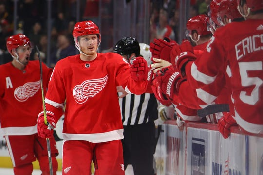 Gustav Nyquist #14 of the Detroit Red Wings celebrates his first period goal with teammates while playing the Vegas Golden Knights at Little Caesars Arena on February 07, 2019 in Detroit, Michigan.