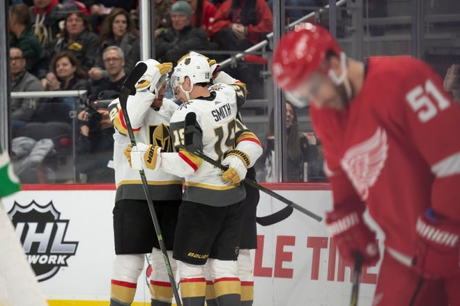 Detroit center Frans Nielsen looks away as Vegas celebrates a goal by center William Karlsson in the second period.