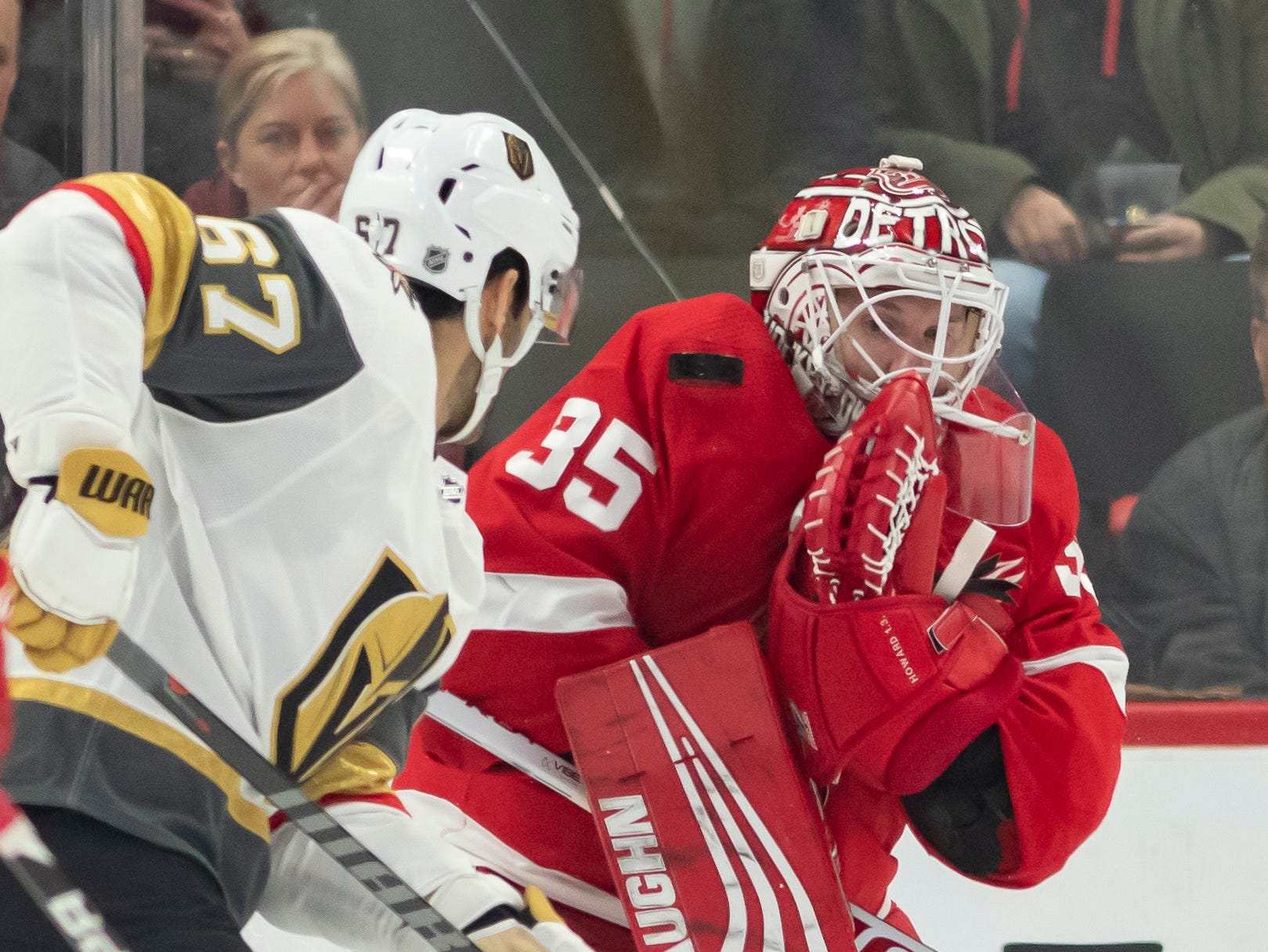 Vegas left wing Max Pacioretty tries to deflect the puck past Detroit goaltender Jimmy Howard in the first period.