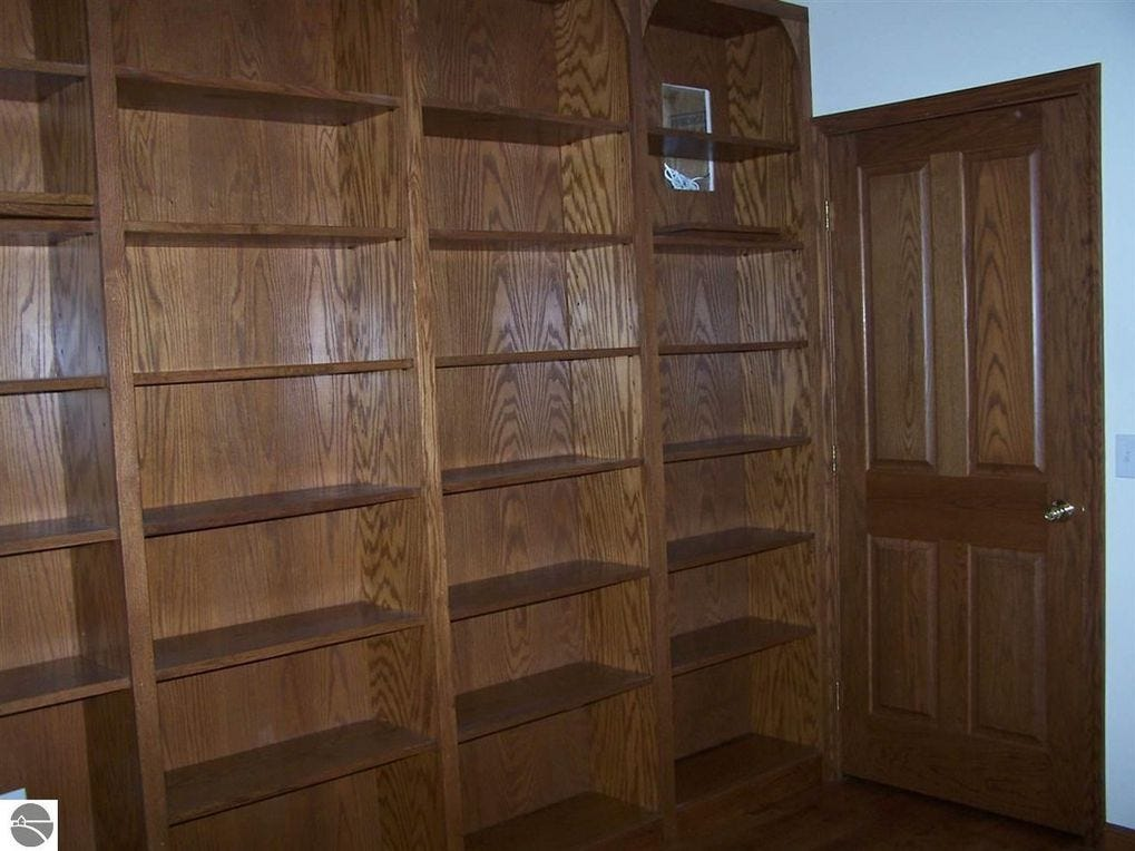 The library, which is also on the first floor, has built-in bookshelves, a Murphy bed for guests and its own bathroom.
