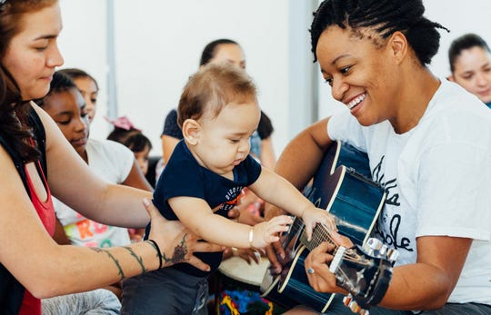 Living Arts teaching artist Alesha Brown teaches a Baby Artsplay workshop at the Ford Resource and Engagement Center.