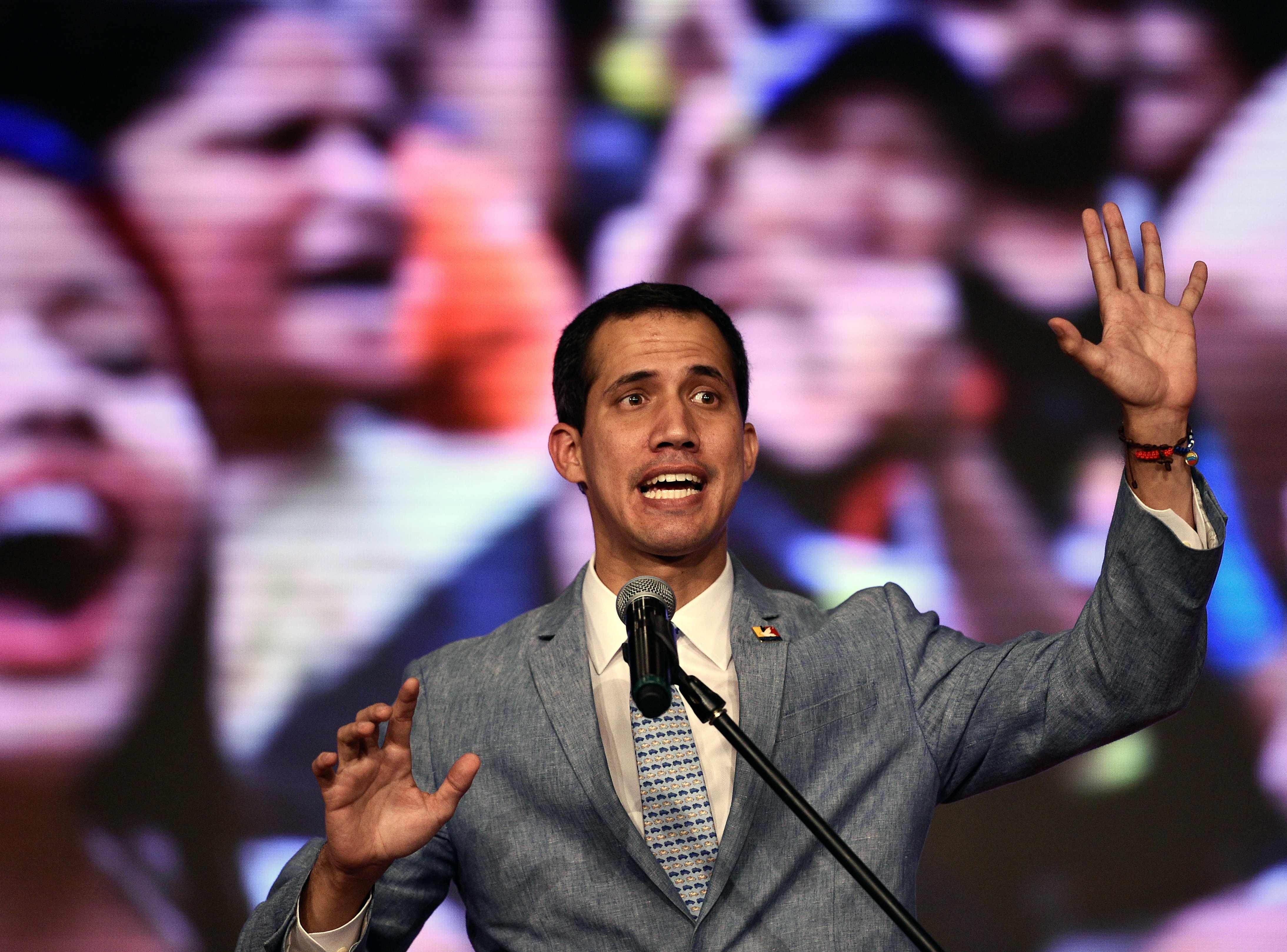 The president of Venezuela's National Assembly and self-proclaimed acting president Juan Guaido delivers a speech at the Central Universidy of Venezuela (UCV) in Caracas on February 8, 2019.