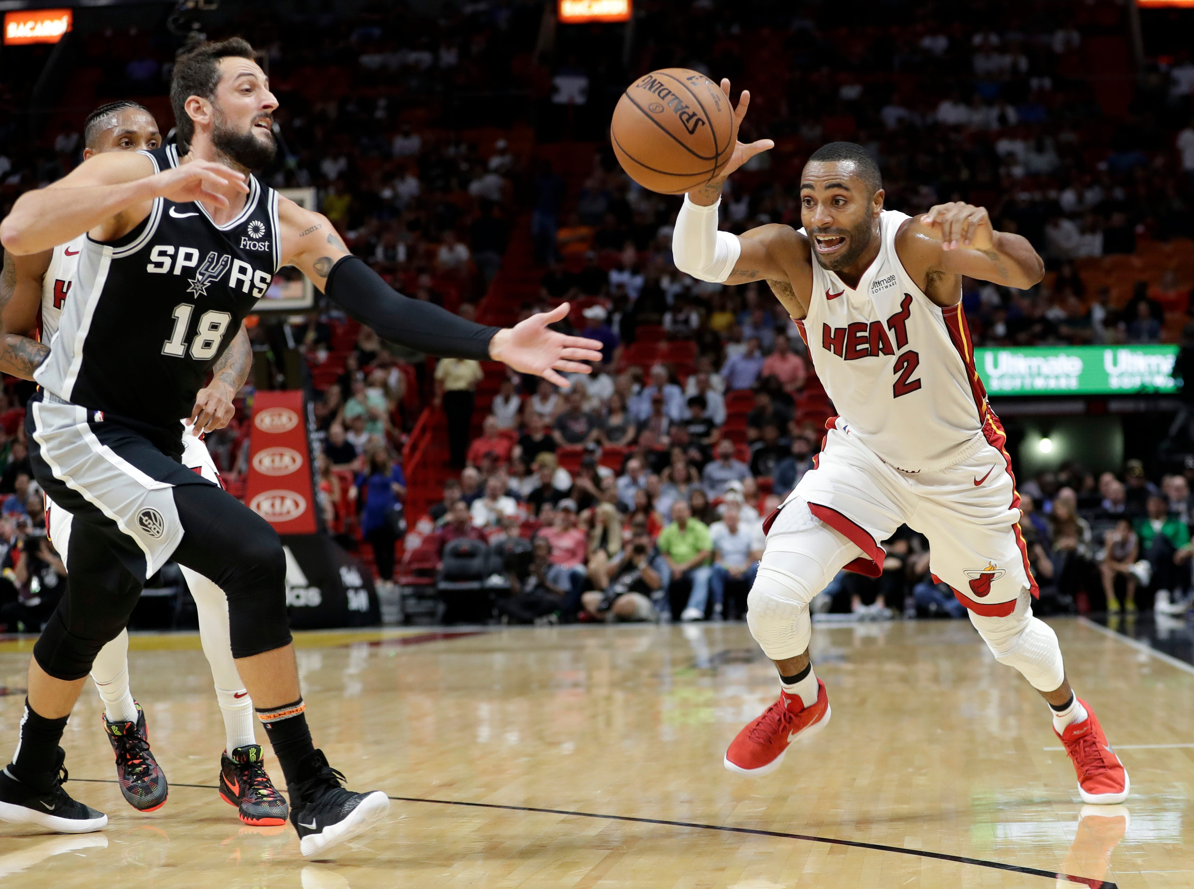 Miami Heat guard Wayne Ellington loses control of the ball as San Antonio Spurs guard Marco Belinelli defends during the first half of an NBA basketball game, Wednesday, Nov. 7, 2018, in Miami.