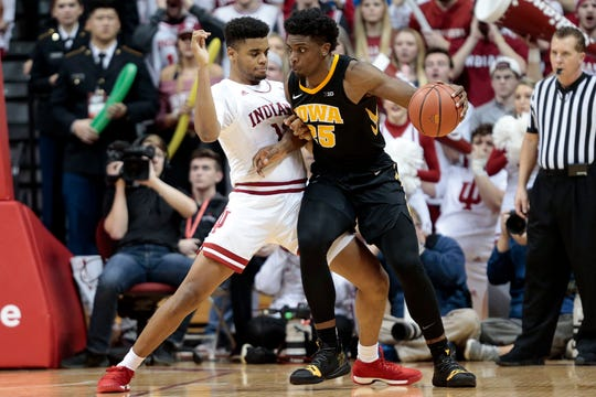 Iowa forward Tyler Cook (25) leans against Indiana forward Juwan Morgan during the second half.