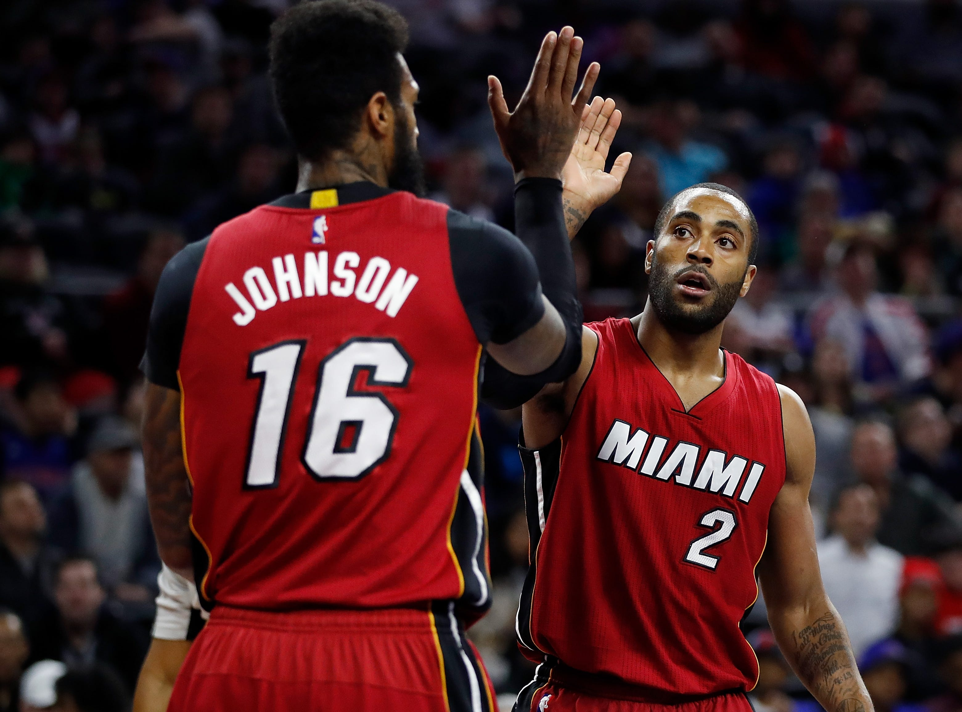 Wayne Ellington of the Miami Heat celebrates a first half play with James Johnson while playing the Detroit Pistons on March 28, 2017.