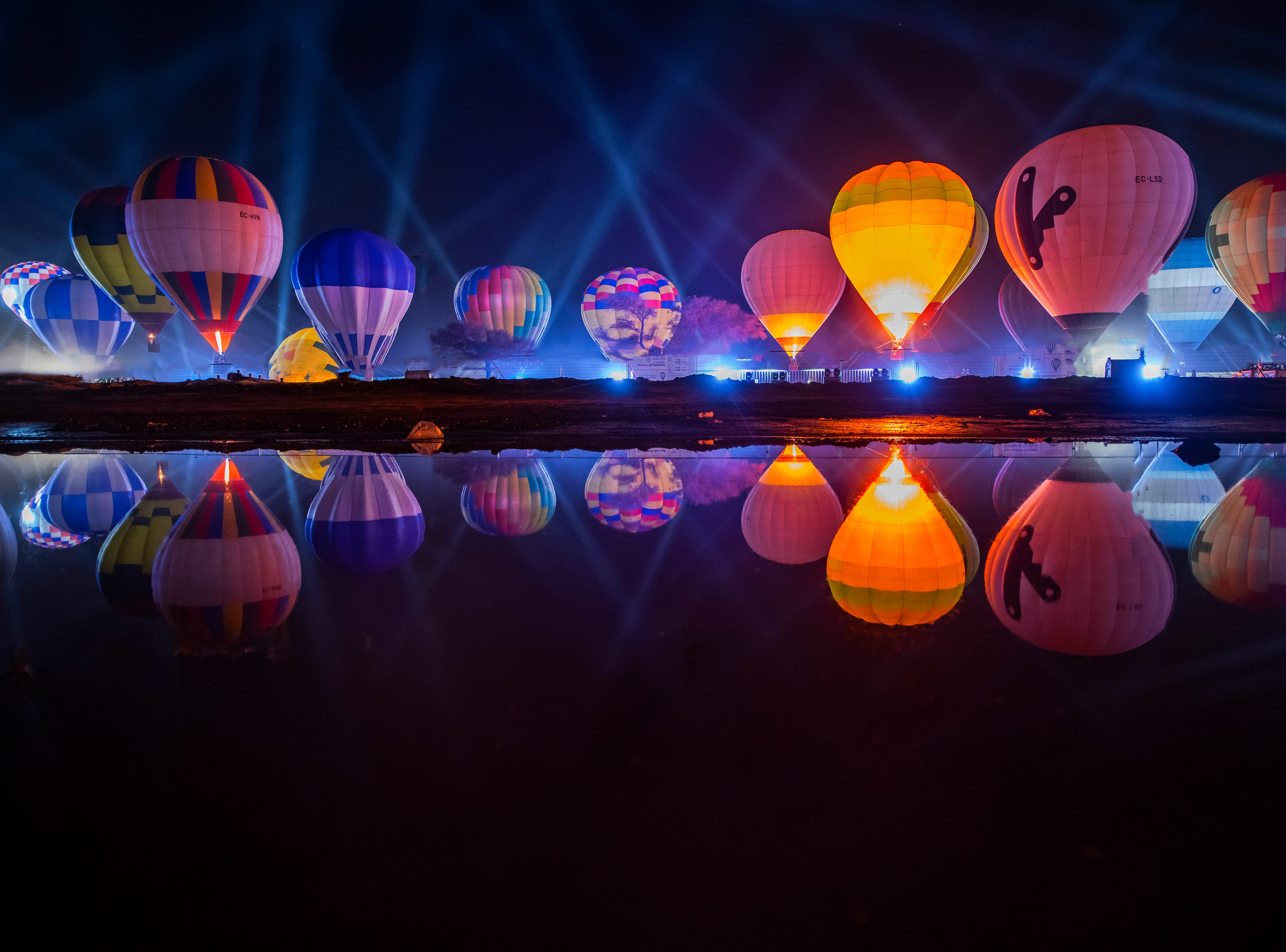 """A scene during the 2019 AlUla Balloon Festival part of Winter at Tantora in Al-Ula, Saudi Arabia. Sixty hot air balloons took to the sky in the region, offering rides to festivalgoers and locals alike. Each night the balloons light up the night skies with a daily """"glow show."""""""