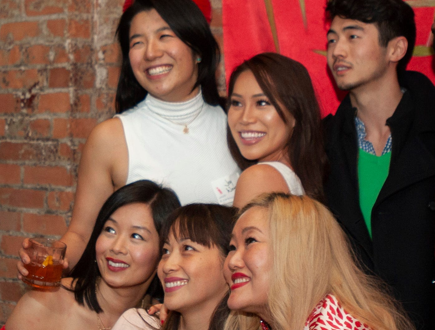 Over the Moon party organizers (top row, from left) Joy Wang, Michelle Nguyen, Stephen Oh and (bottom row, from left) Jennifer Vuong, Gowhnou Lee and Esther Kim pose for a group photo while celebrating the Lunar New Year  east-Asian style at Detroit City Distillery in Eastern Market on Thursday, February 7, 2019.