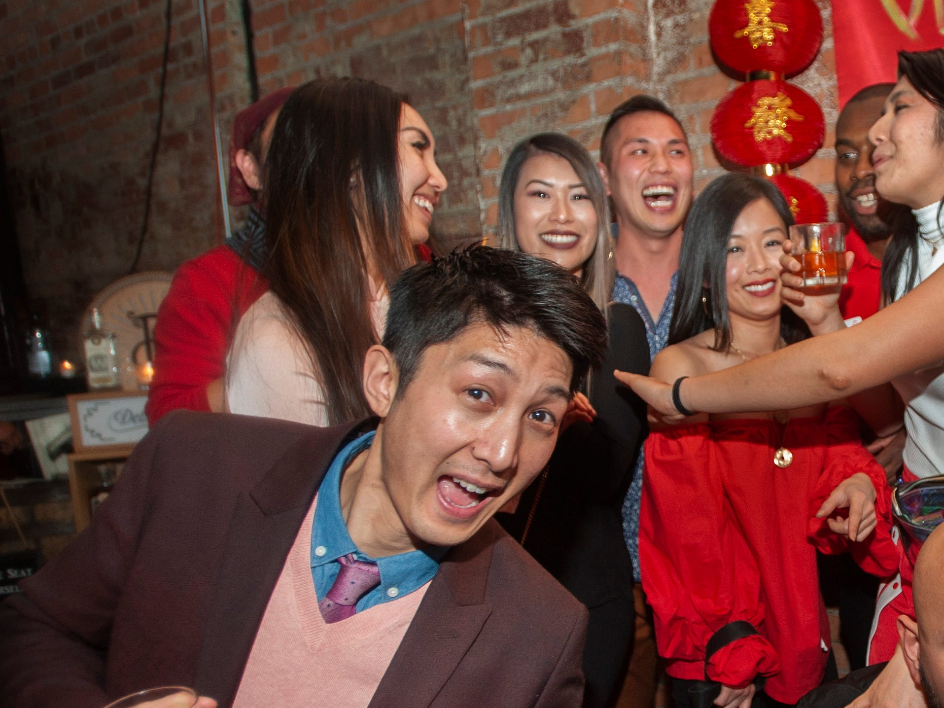 Over the Moon party goer David Tran of Windsor, Ontario enjoys enjoys celebrating the Lunar New Year with an east-Asian style party at Detroit City Distillery in Eastern Market on Thursday, February 7, 2019.