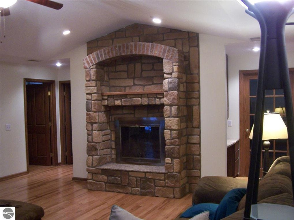 The family room and the living room each have a fireplace.