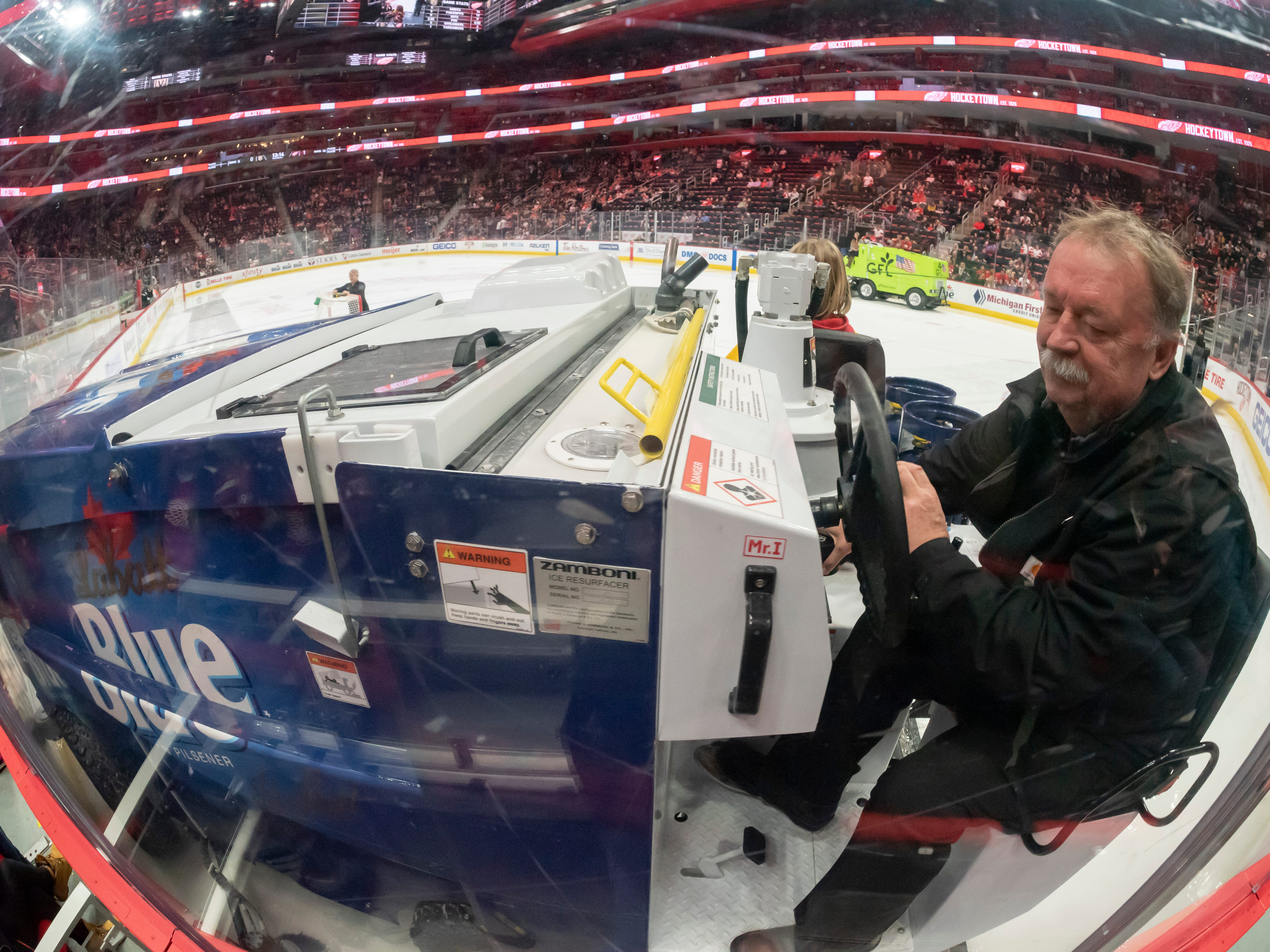Al Sobotka uses a Zamboni to flood the ice between periods.