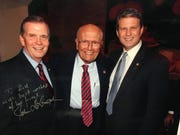 U.S. Rep. Bill Huizenga, R-Zeeland, at right, keeps this signed photo of him, Reps. John Dingell and Tim Walberg in his office.
