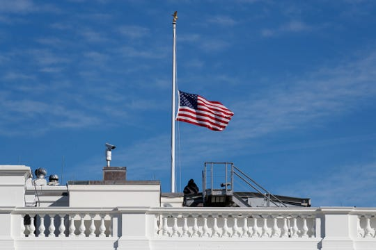 The flag of the United States is lowered to half-staff at the White Hous, Friday,  in honor of former Michigan Rep. John Dingell, the longest-serving member of Congress in American history.