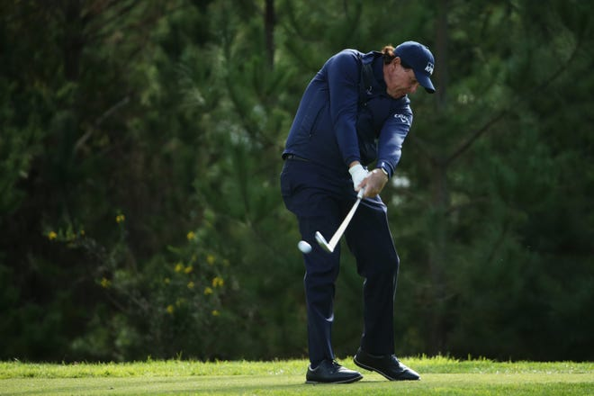 Phil Mickelson plays his shot from the 18th tee during the first round of the AT&T Pebble Beach Pro-Am.