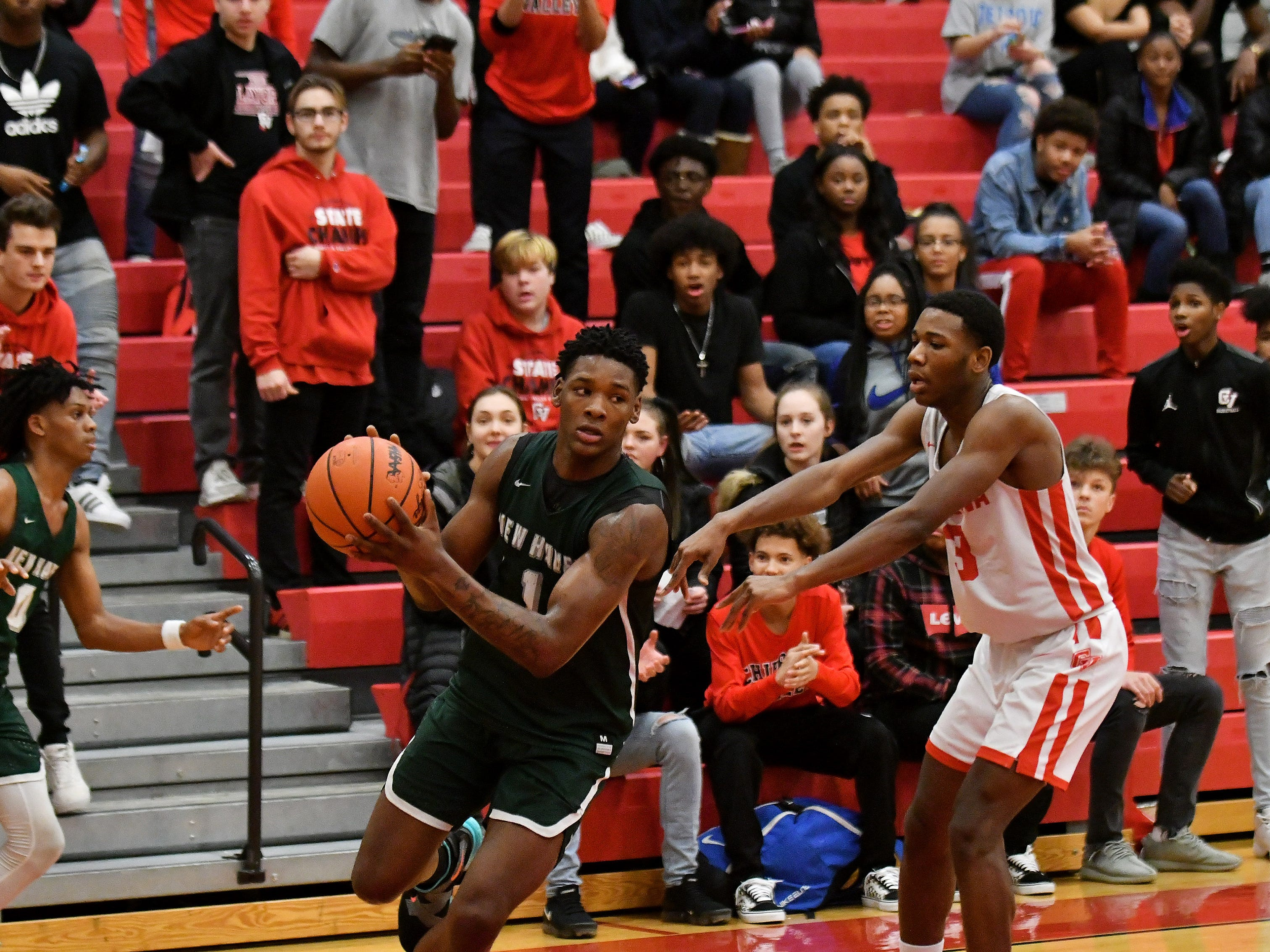 The Chippewa Valley student section watches closely while New Haven's Romeo Weems (1) is guarded by Chippewa Valley's Corey McCray (3) in the second half.