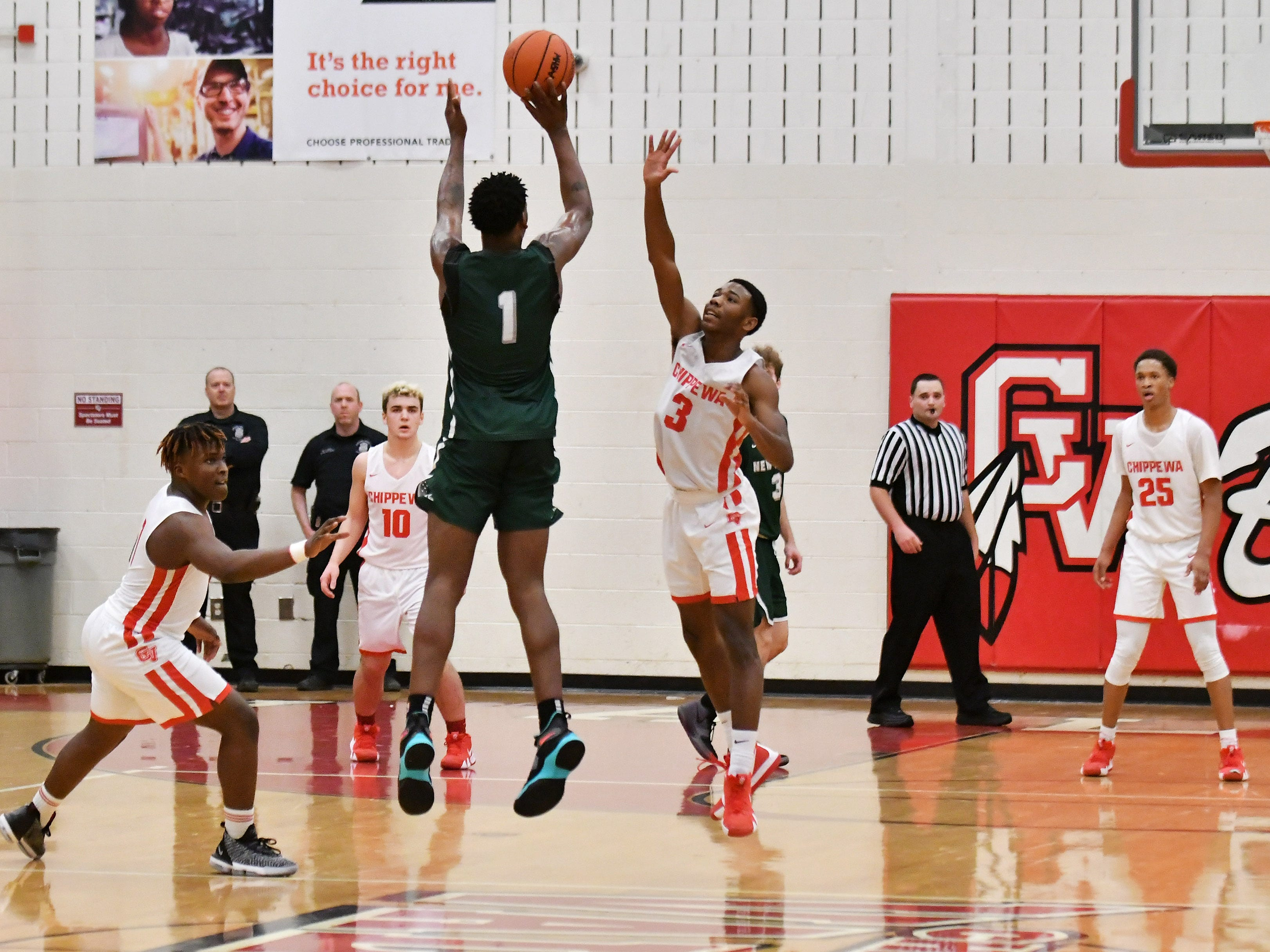 Chippewa Valley's Corey McCray (3) and Myren Harris, left, defend a shot by New Haven's Romeo Weems in the second half.