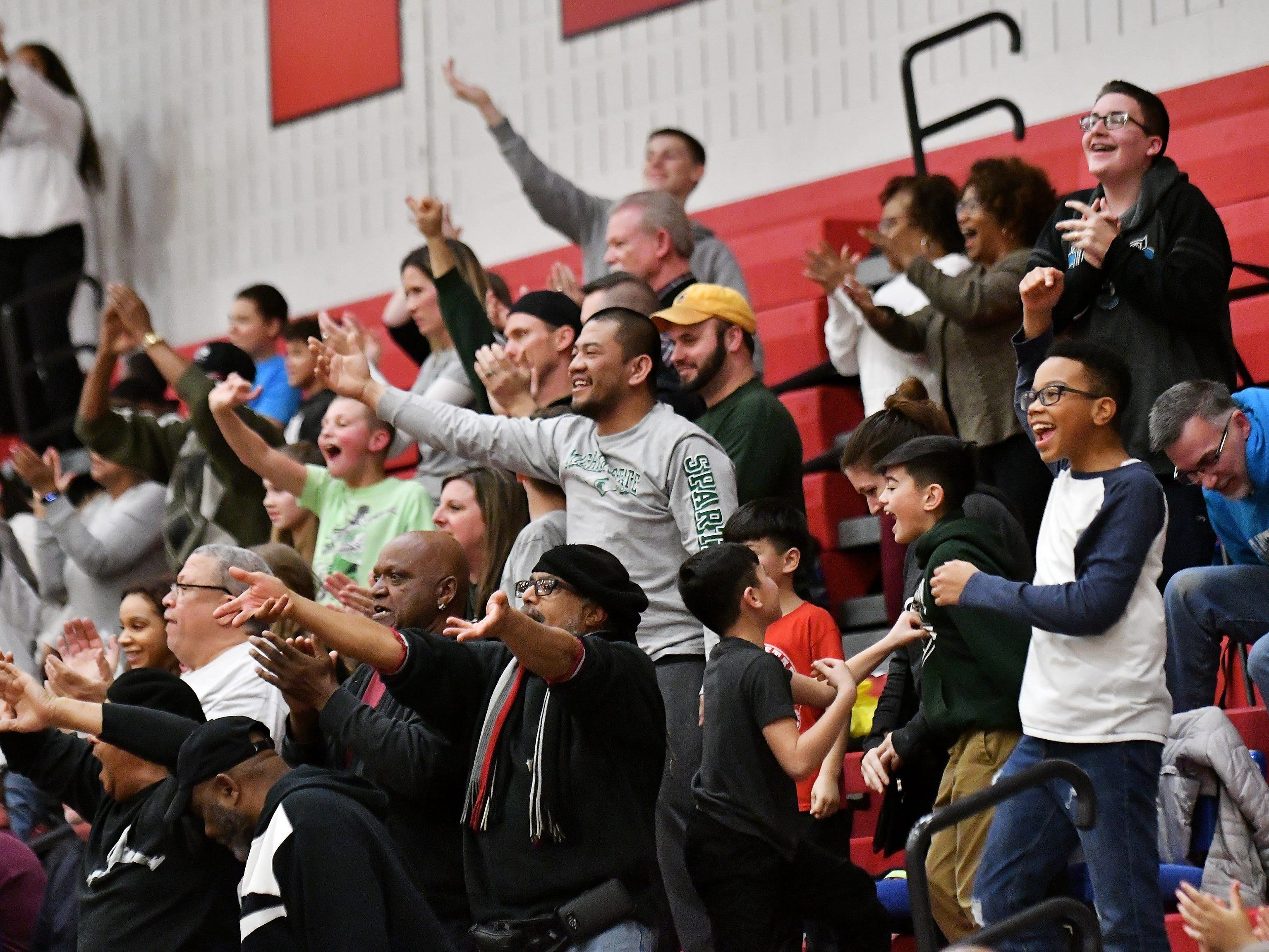 New Haven fans taunt the Chippewa Valley fans after New Haven regains the lead in the second half.