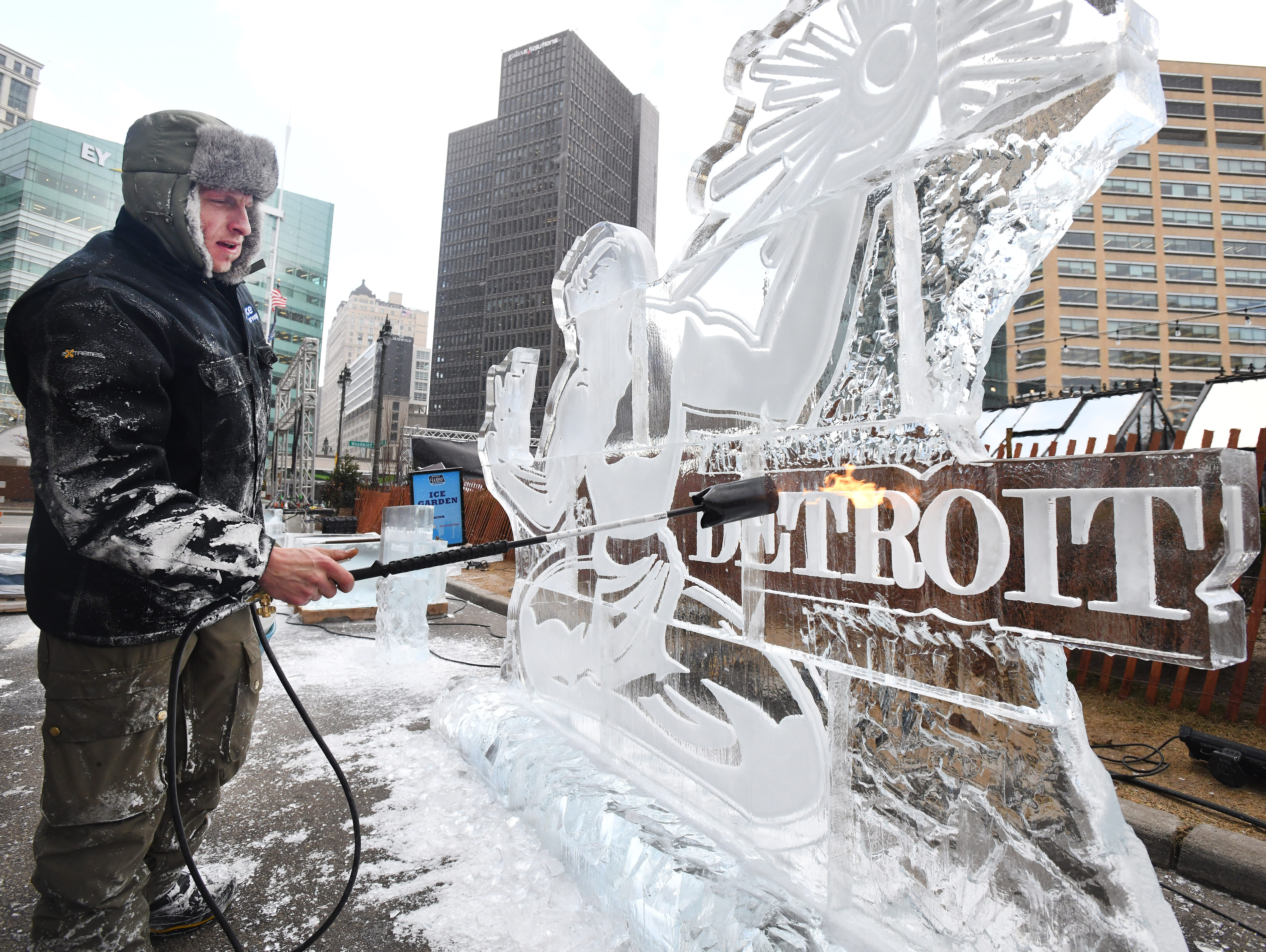 Brad Groszkiewicz of US Ice Carvings works on torching an ice sculpture piece for the 2019 Motown Winter Blast Friday in Detroit.