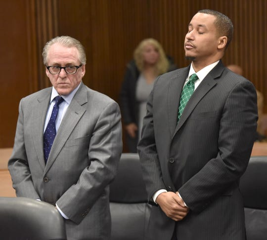 Former state Senator Virgil Smith, right, takes a deep breath Friday as he appears with his defense attorney, David Steingold, in front of Wayne County Circuit Court Judge Lawrence Talon.