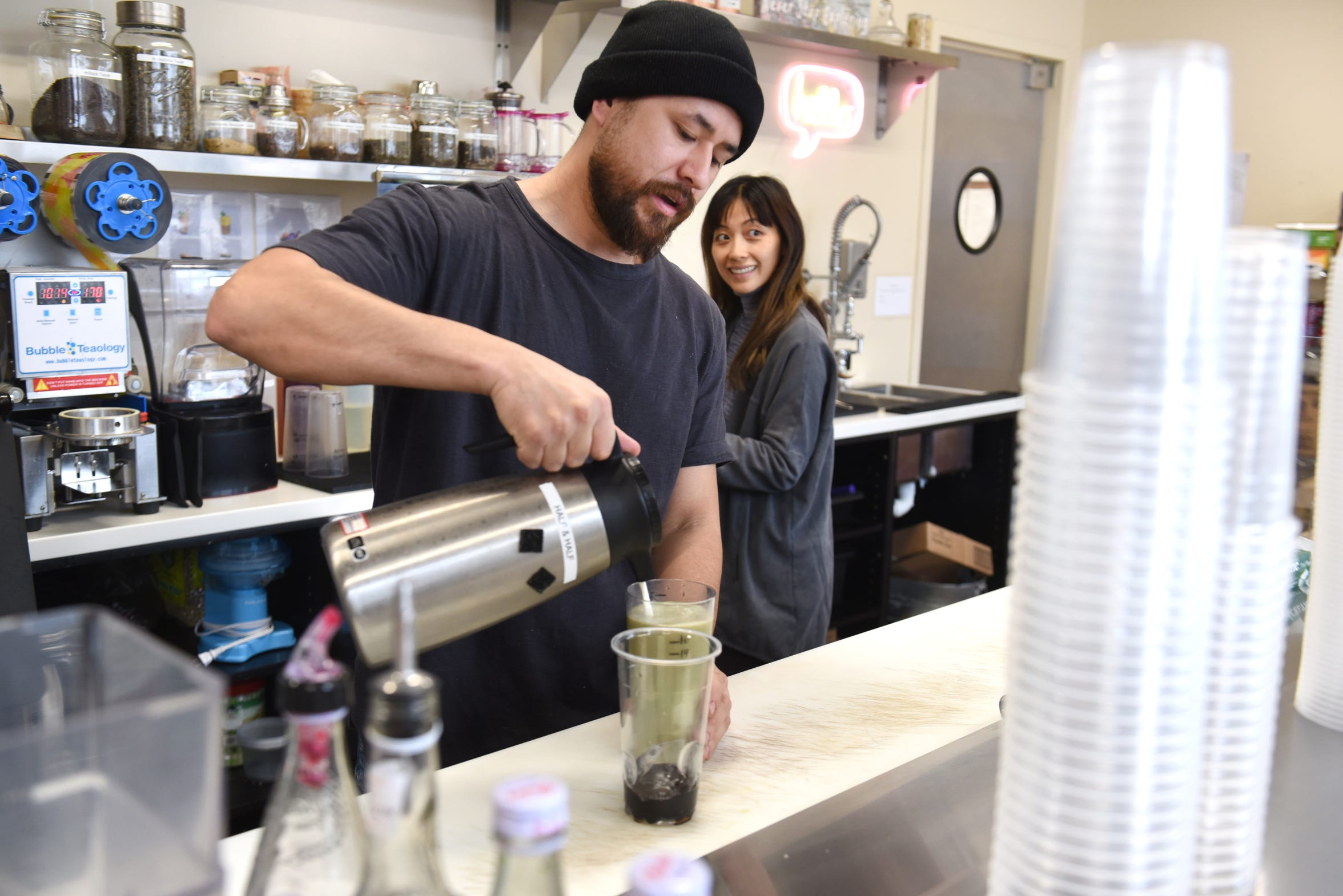 Cedric Lee (left) and his wife Gowhnou, owner of Tou & Mai, make a honey dew sweet boba drink on Wednesday, February 5, 2019 at the midtown Detroit store.